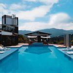 Happy Buddha Hostel Guatapé piscina peñol vereda el morro alojamiento reserva whatsapp